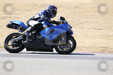 Superbike #76 stock photo, High speed Superbike on the circuit  by Sean Nel