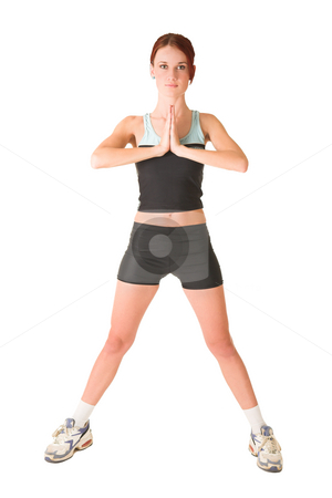 Gym #143 stock photo, Woman standing with hands together. White background. by Sean Nel