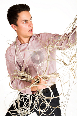 Businessman #122 stock photo, Businessman tangled up in an extension cord. by Sean Nel