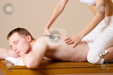 Massage #5 stock photo, Masseuse working on a man by Sean Nel