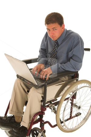 Businessman #134 stock photo, Businessman sitting in wheelchair with a laptop by Sean Nel