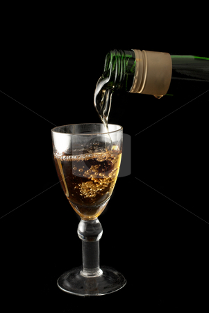 Wine And Glass #2 stock photo, Wine is being poured into a glass - black background by Sean Nel