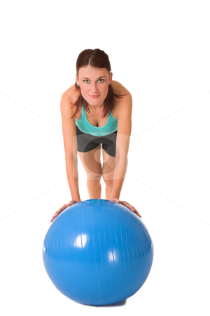 Gym #171 stock photo, Woman in gym wear leaning on blue ball. by Sean Nel
