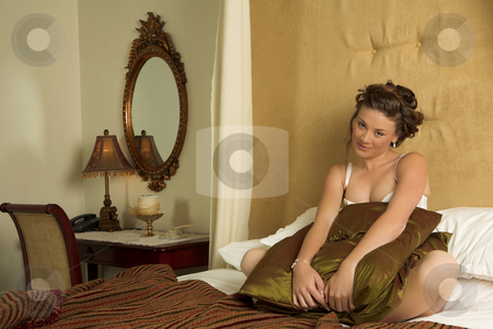 Lingerie#264 stock photo, Woman in underwear sitting on a bed. by Sean Nel