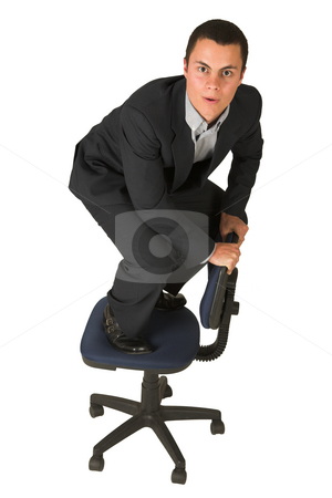 Businessman #231 stock photo, Businessman wearing a suit and a grey shirt.  Making a stunt on an office chair by Sean Nel