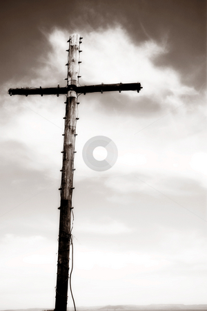 Wooden cross stock photo, Wooden cross with electric lights on the edges against a blue sky ? Brown duotone, High Key by Sean Nel