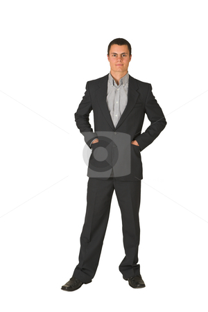 Businessman #226 stock photo, Businessman wearing a suit and a grey shirt.  Standing  with both hands in his pockets by Sean Nel