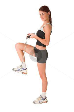 Gym #167 stock photo, Woman standing in gym wear with skipping rope around her foot. by Sean Nel
