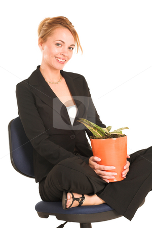 Businesswoman #264 stock photo, Blonde business lady in formal black suit. Sitting on an office chair with pot plant on her lap.  Smiling. by Sean Nel