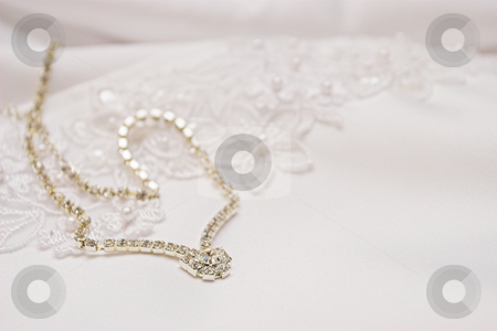 Jewellery #1 stock photo, Bridal jewellery on wedding gown by Sean Nel