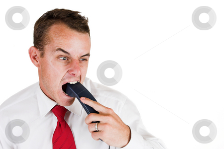 Tollie Booysen #14 stock photo, Businessman in white shirt and red tie. Biting the telephone. by Sean Nel
