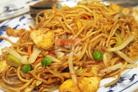Plate of Chicken Chow Mein stock photo, Plate of Chicken Chow Mein. A Chinese food dish of fried noodles with sweet and sour chicken pieces as well as some vegetables like onions and carrots. by Sean Nel