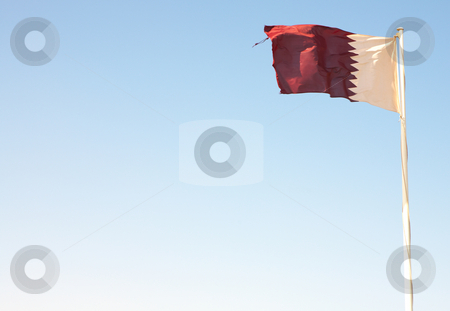 National flag of Qatar stock photo, National flag of Qatar waving against a blue desert sky (movement on edges) by Sean Nel