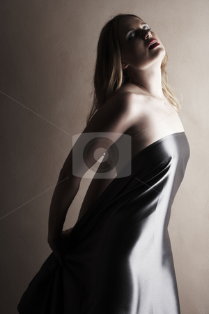 Nude adult woman stock photo, Sensual naked young blonde adult Caucasian woman, wrapped in a satin, silk sheet. high key image. by Sean Nel