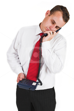 Business man #27 stock photo, Business man in a suit with a blue telephone by Sean Nel