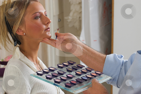 Makeup #2 stock photo, Model receives professional makeup from Make-up artist by Sean Nel