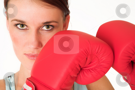 Gym #39 stock photo, A woman in gym clothes, with boxing gloves by Sean Nel