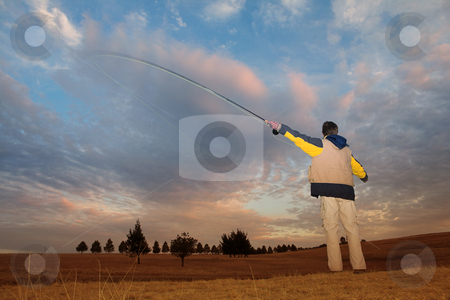 Flyfishing #2 stock photo, A fly fisherman casting a line in Dullstroom, South Africa by Sean Nel