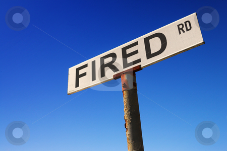 Sign against blue sky stock photo, Weathered old road sign against a clear blue sky - Concept image: FIRED by Sean Nel