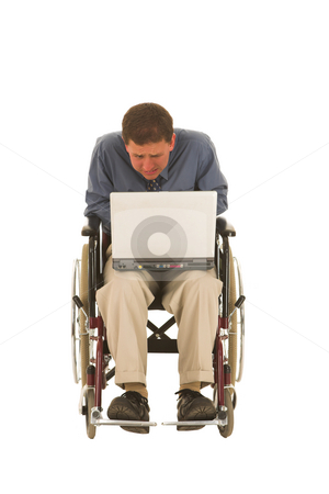 Businessman #130 stock photo, Man sitting in wheelchair working on a laptop. by Sean Nel