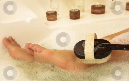 Woman #65 stock photo, Bare feet in a bubble bath by Sean Nel