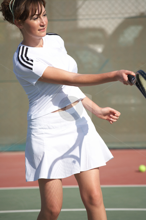 Female Tennis Players stock photo, Young women playing tennis in the sun - movement on extremities by Sean Nel