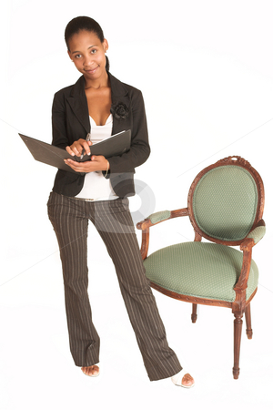 Mida Matsimela #8 stock photo, African business woman dressed in black jacket.  Standing next to a chair, holding a file. by Sean Nel
