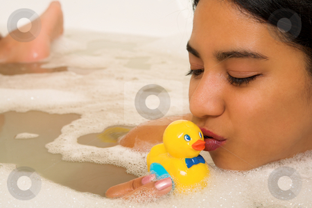 Woman #69 stock photo, Nude woman in a bath, kissing a plastic duck. by Sean Nel
