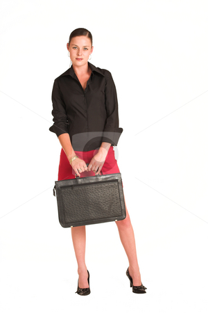 Business Woman #14 stock photo, Business woman dressed in a black shirt and red skirt.  Holding a leather suitcase by Sean Nel
