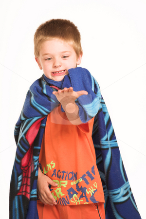 Kids #1 stock photo, A boy wearing a blanket as a cape, looking at his hand. by Sean Nel