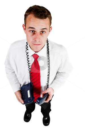 Tollie Booysen #25 stock photo, Businessman in black trousers, white shirt and red tie. Holding telephone by Sean Nel