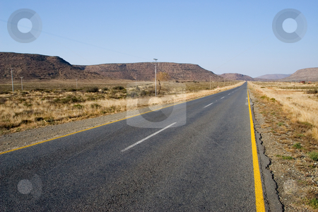 Cape roads #2 stock photo, Desolate road just outside Colesberg, South Africa by Sean Nel