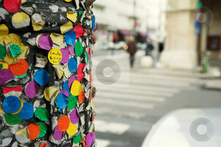 Colorful stickers stock photo, Colorful stickers on a streetlight pole in Vienna, Austria by Sean Nel