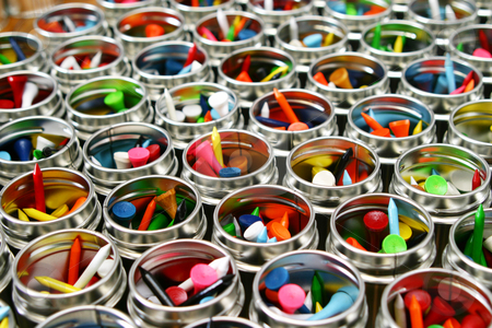 Golf tees stock photo, Colorfull golf tees by Sean Nel