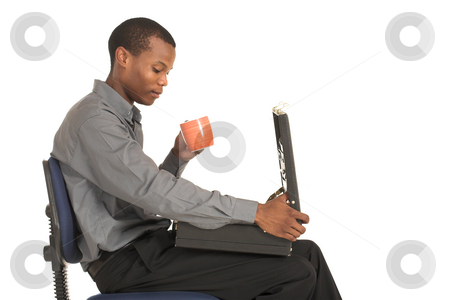 Businessman #162 stock photo, Businessman sitting on chair, holding a cup and looking down at the suitcase on his lap.  Copy space. by Sean Nel