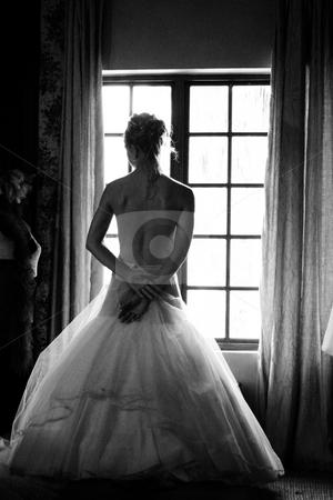 Bride at the window stock photo, Semi-nude bride by Sean Nel