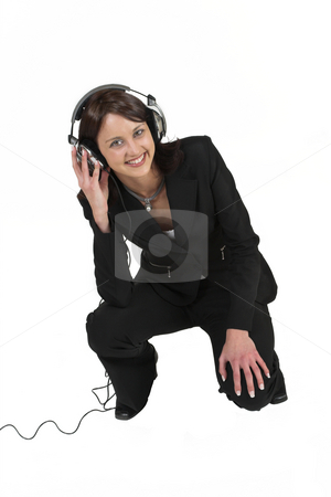 Luzaan Roodt #17 stock photo, Business woman in formal black suit with headphones on her head by Sean Nel