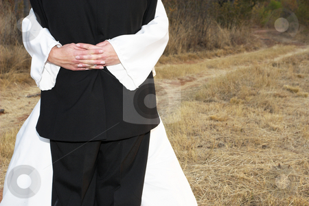 Wedding #13 stock photo, Bridal couple standing on a dirt road in an embrace by Sean Nel