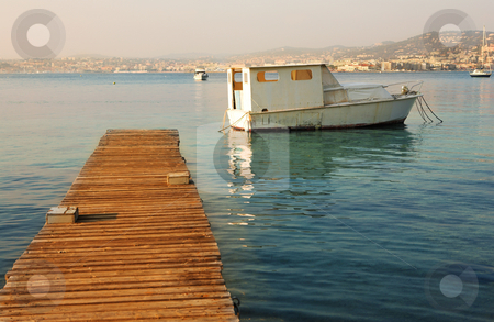IsleDeMarguerite #32 stock photo, Old fishing boat next to the pier of Ile Sante-Marguerite  by Sean Nel