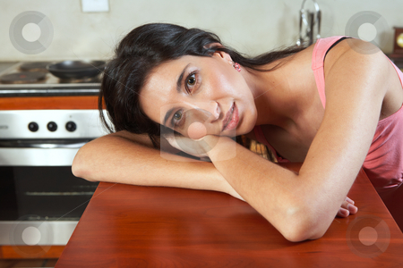 Sexy brunette woman stock photo, Sexy young adult brunette woman in lingerie lying on her kitchen counter by Sean Nel
