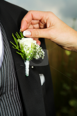 Wedding #38 stock photo, Close-up of Bridal accessories. Hand of bride fixing a Corsage. by Sean Nel