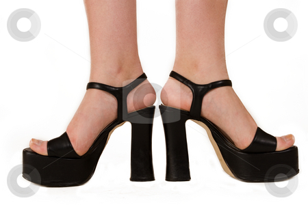 Fashionable feet 1 stock photo, Ladies feet in black high sole shoes by Sean Nel
