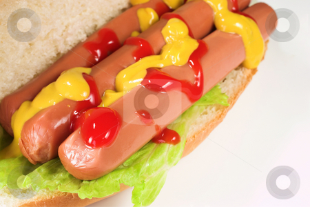 Food #23 stock photo, A hot dog covered in tomato sauce and mustard on a white plate. by Sean Nel