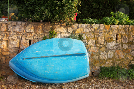 IsleDeMarguerite #14 stock photo, Old blue rowboat against a wall by Sean Nel