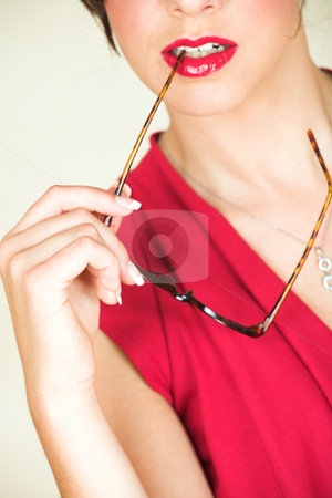 Young adult businesswoman stock photo, Young Caucasian adult businesswoman in a red, discreet, office wear with glasses, and red lips by Sean Nel