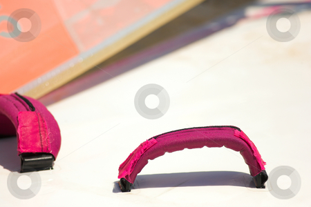 Windsurfer board straps stock photo, Pink board straps and foot holds on a windsurfing board by Sean Nel