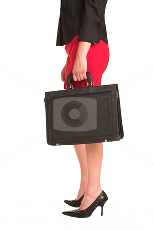 Charmaine Shoultz #1 stock photo, Business woman dressed in a black shirt and red skirt.  Holding a black leather suitcase by Sean Nel