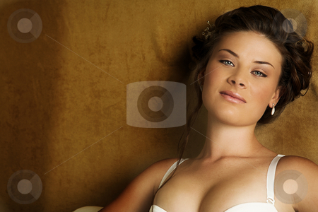 Lingerie#242 stock photo, Woman in underwear sitting on a bed. by Sean Nel