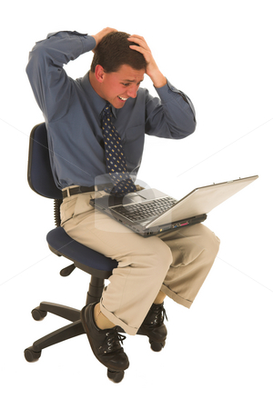 Businessman #73 stock photo, Man upset working on laptop. by Sean Nel