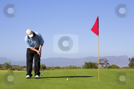 Golf #53 stock photo, Man playing golf. by Sean Nel